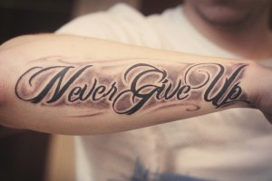 inspire_never_give_up_quote_tattoo_on_arm